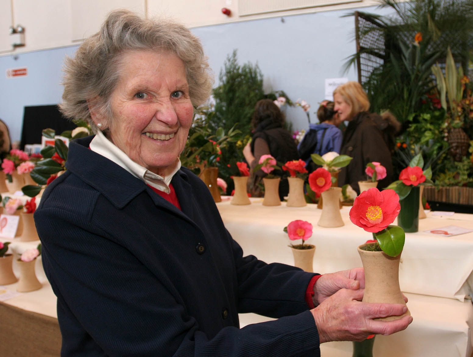 The 84th West Cornwall Spring Show organised by The West Cornwall Horticultural Society in St JohnÕs Hall Penzance. Elizabeth Bolitho with her 1st prize winning Camellia. Pic by Roger Pope/CIOSP