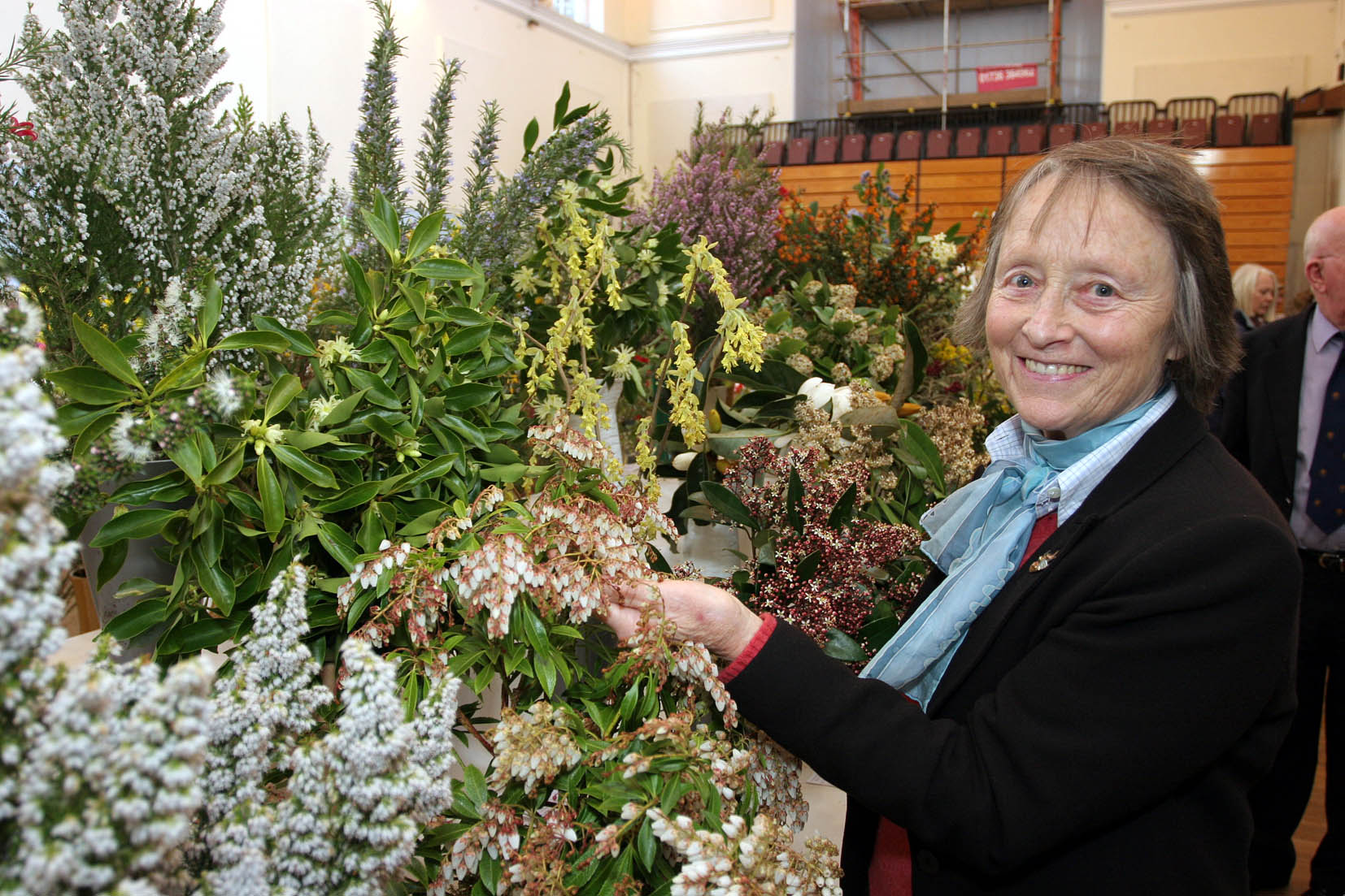 The 84th West Cornwall Spring Show organised by The West Cornwall Horticultural Society in St JohnÕs Hall Penzance. Lady Banham from Penberth Gardens checks her entry of six shrubs which took 1st place in the Ornamental Shrub Section. Pic by Roger Pope/CIOSP